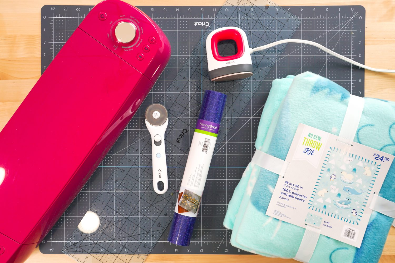 Supplies needed for this project: Cricut Explore, fleece blanket kit, rotary cutter, ruler, cutting mat, EasyPress Mini