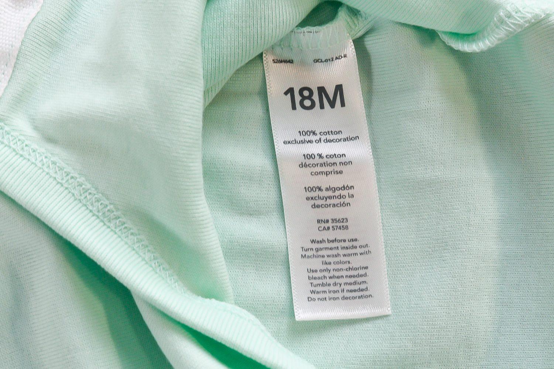 Closeup of 18M cotton onesie tag