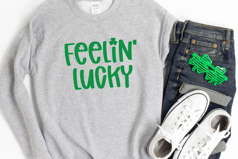"""Gray Sweatshirt with """"Feeling Lucky"""" on it"""
