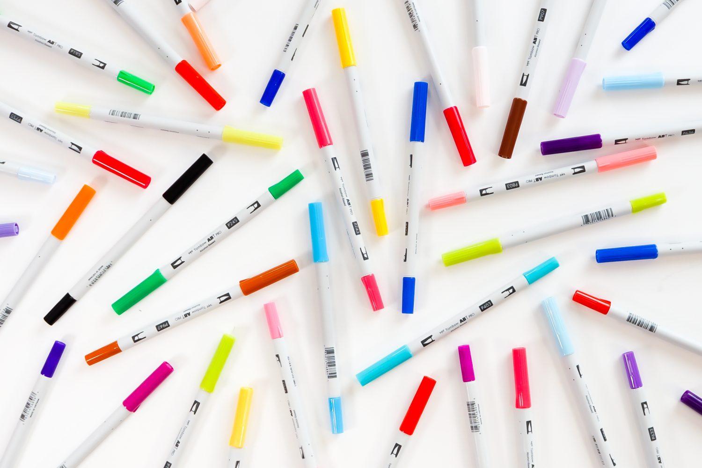 ABT PRO pens scattered on desk.