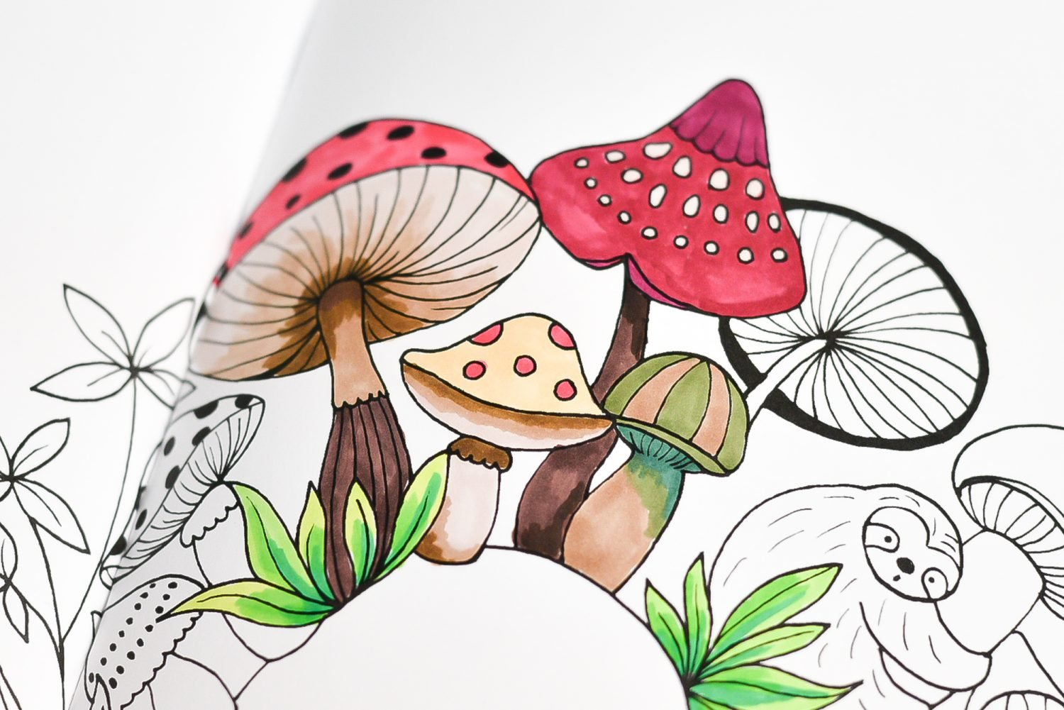 Close up of coloring book with blended colored mushrooms