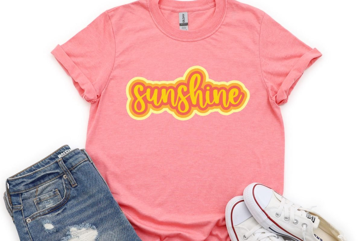 Sunshine image on pink shirtAfter many years of asking, Cricut users can now offset their designs in Cricut Design Space! An offset is basically a solid outline/shadow around text or images. The new Cricut offset tool makes it easy!