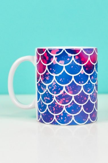 Mermaid mug on teal background made with mermaid mug wrap design