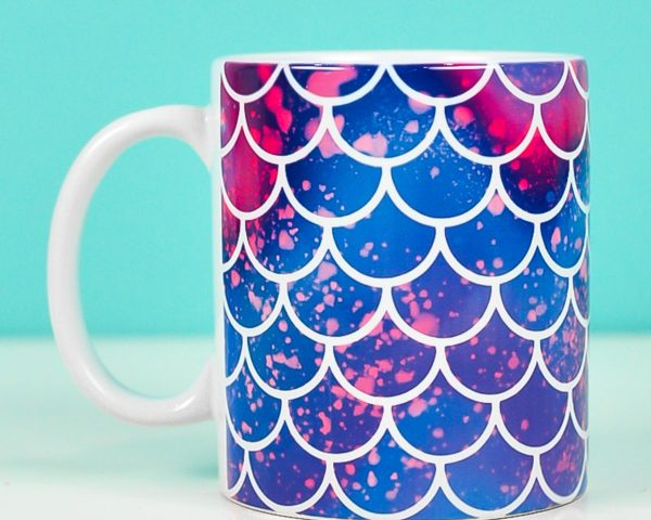 Mermaid mug on teal background made with mermaid mug wrap design